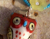 Brown porcelain owl on seed bead cord