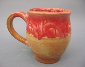 Handmade mug in red and tan