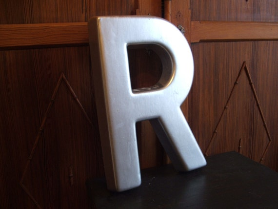 large silver plastic wall sign letter r With large plastic letters for walls