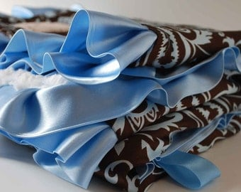 SHILOH.......BABY BLANKET Two toned blue minky with brown and blue paisley satin and ruffled trim.....Elegant baby blanket