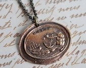 HOPE anchor wax seal necklace in bronze... A scene with a ship and a bird perched on an anchor that leans against a rock