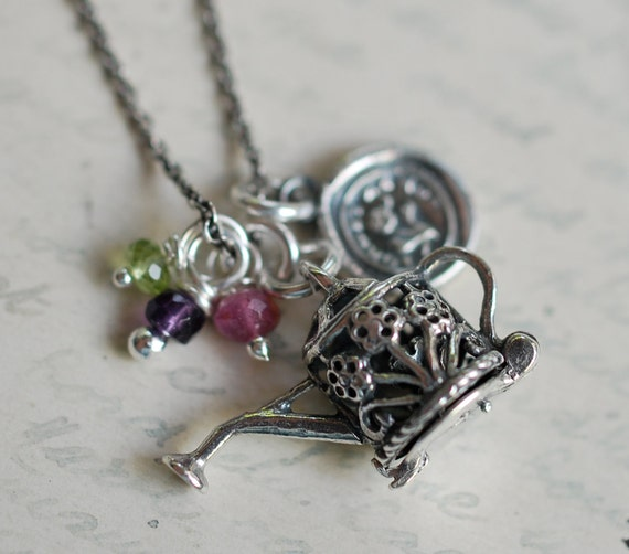 The Gardener... forget me not wax seal and watering can locket cluster charm necklace