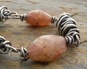 Orange Bracelet:  Sunstone Gemstones, Wire Wrapped, Sterling Silver, Oxidized