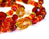 Colorful, juicy, two strands gypsy necklace and earrings set by Maxime B