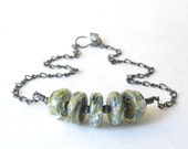 lampwork glass 'caterpillar' beads and sterling silver wire wrapped necklace