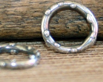 Bumpy Links Small round Sterling TWO  002/OR50