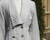 Vintage 1980's white half trench coat with gold zippers and buttons