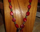 CORAL NUGGETS WITH AMAZING RED BLACK AND GOLD FOCAL