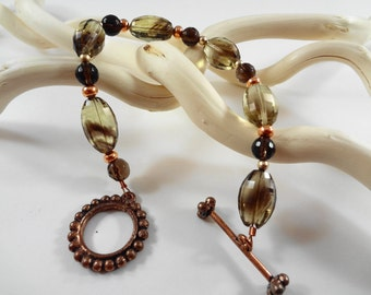Bi Color and Smoky Quartz 6.5 inch beaded Bracelet with Sand Blasted 14kt Gold Filled beads and a Copper Toggle Clasp