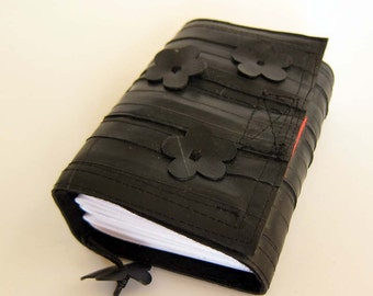 Recycled bike inner tube notebook,bound, handcut flowers, blank pages, black linen and neon orange velcro closure, small.