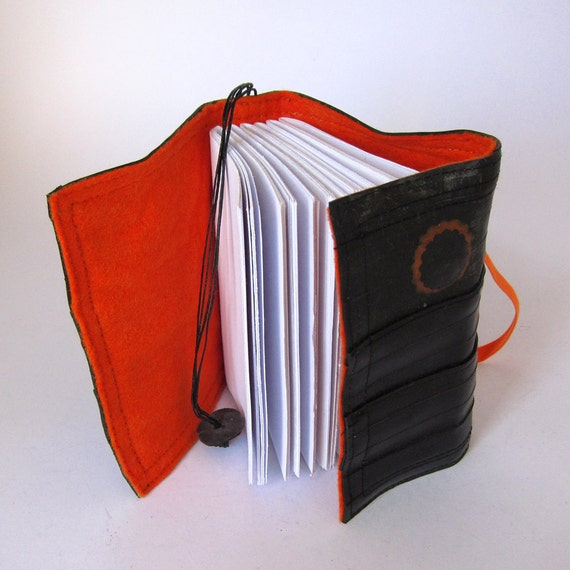 Recycled journal, bike inner tube, blank pages, orange linen and elastic, small.