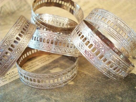stamped metal napkin rings for repurposing or everyday use. set of 7