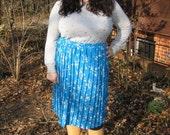 1980s plus size pleated sky blue skirt.
