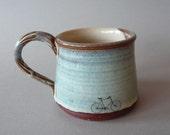 Left handed bike mug