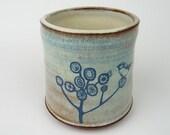 Blue Bird in Tree Cup