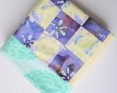 Batik and Pom Poms Patchwork Blanket