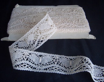 22 yds of cluny lace with butterfly design
