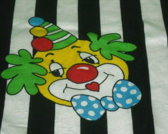 vintage 50s novelty juvenile fabric, featuring fun clown motif, 1 yard