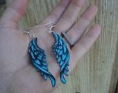 tattoo style earrings blue wings