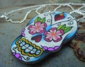 vintage tattoo style dia de los muertos (day of the dead) sugar skull with flowers and sacred heart necklace