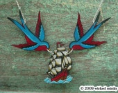 helloooo sailor.... vintage tattoo blue and red swallow and pirate ship necklace
