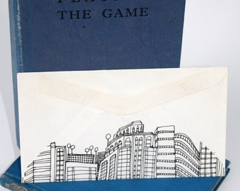 Drawing on Up-cycled Small Envelope, featuring Urban Skyline
