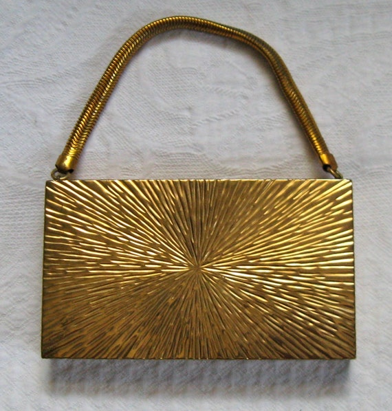 Vintage COMPACT PURSE  star burst by Evans 1940s