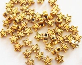 100 Tiny Star Metal Spacer Beads 4mm ITEM:AQ15