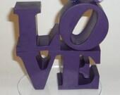 love wedding cake topper with birds philadelphia love park sculpture