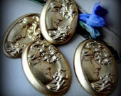 Pretty girl with flowing hair vintage oval metal cameos