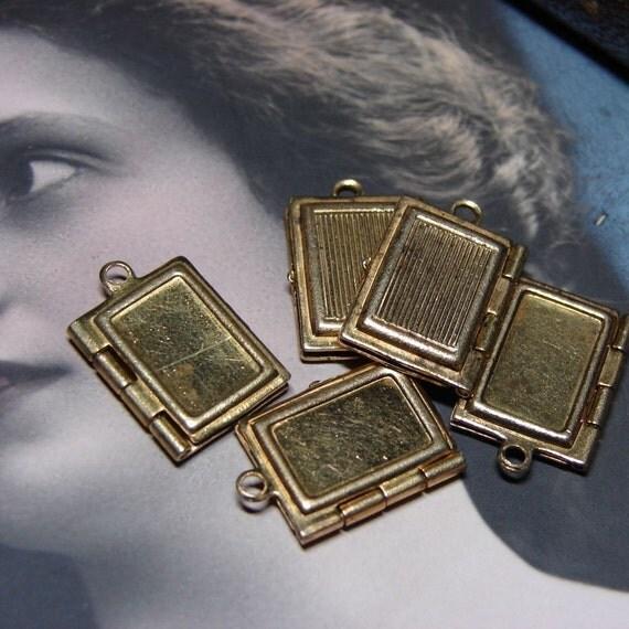 5 small vintage book shaped lockets