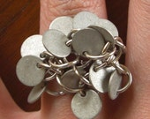 Metallic Disc Cluster Ring