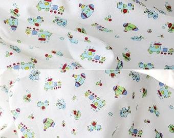 2798 - Toy Aeroplane Boat Submarine Train Car Cotton Jersey Knit Fabric - 70 Inch (Width) x 1/2 Yard (Length)