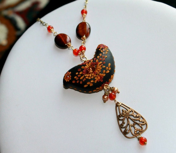 Long Brass bird Necklace with black gold and crystal bird, Tiger eye, Juicy fiery carnelian , gold pearls and brass connector - Flying High