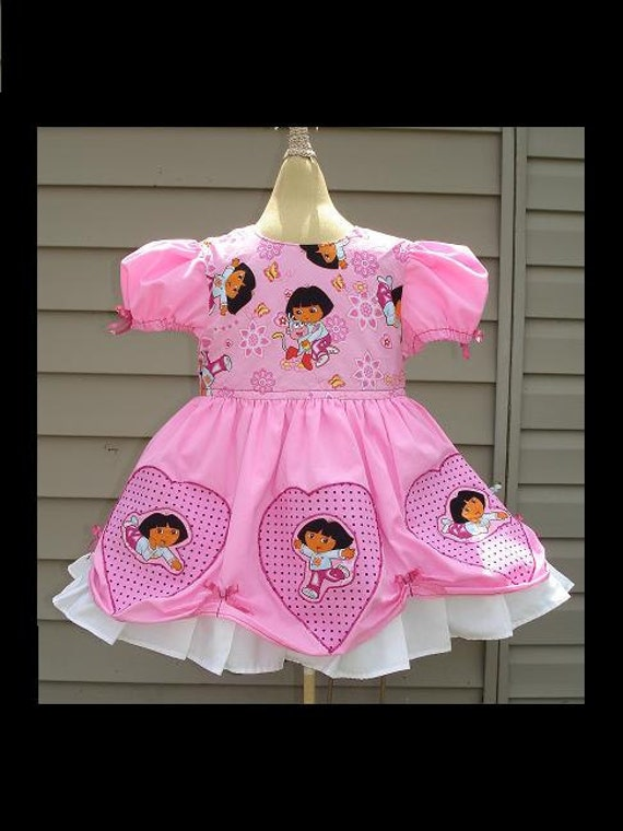 Dora The Explorer(-----)Princess Dress(-----)Appliqued hearts and Hot Pink Bows(-----)Sizes 12 months to Girls size 8