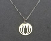 sterling silver lotus coin charm by rockedjewelry