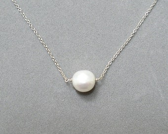 white freshwater pearl silver necklace by rockedjewelry