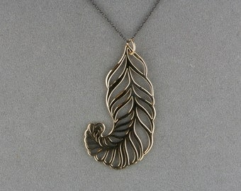 bronze feather pendant necklace on blackened silver chain