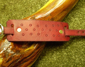 Hand Tooled Cranberry Leather Cuff Bracelet with Brass Buckle Closure
