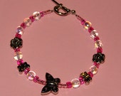 Handmade Bracelet with Toggle Clasp in Clear Iridescent butterflies and flowers
