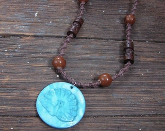 Ms. Peacock - Ceramic and Wood Beaded Brown Hemp Necklace with Blue Pendant