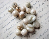 16 vintage pale pink cream glass beads