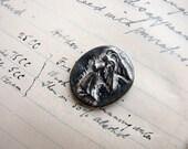 metal angel medallion or cabochon