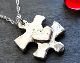 Puzzle Piece Necklace in Sterling Silver