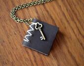 Key Book Necklace - Brass