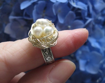 White Pearl Fairy Magic  birdnest ring on silver floral adjustable band