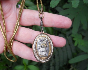 Steampunk Altered Art locket with engraved vines on brass snake chain unisex