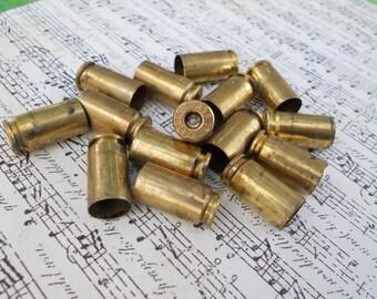 15 brass shell casings 40 caliber primer removed