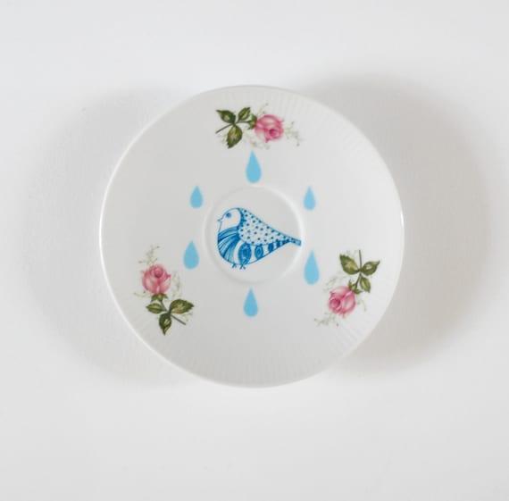 Little bird in the rain plate