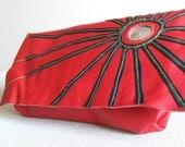Red leather sunburst clutch